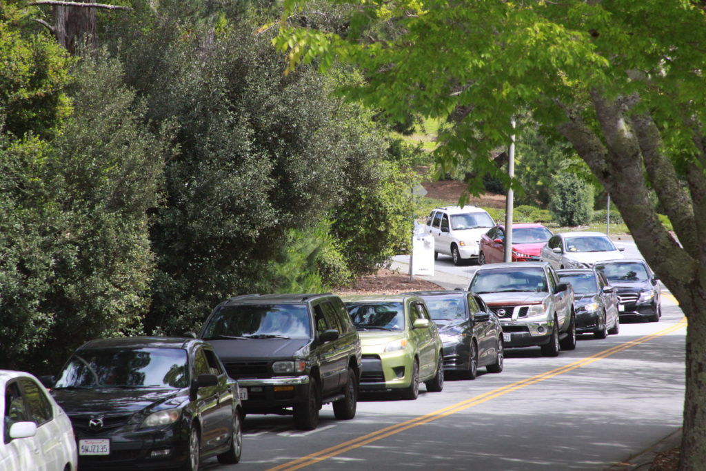 Cars line up for the SMCCCD Emergency Food Distribution